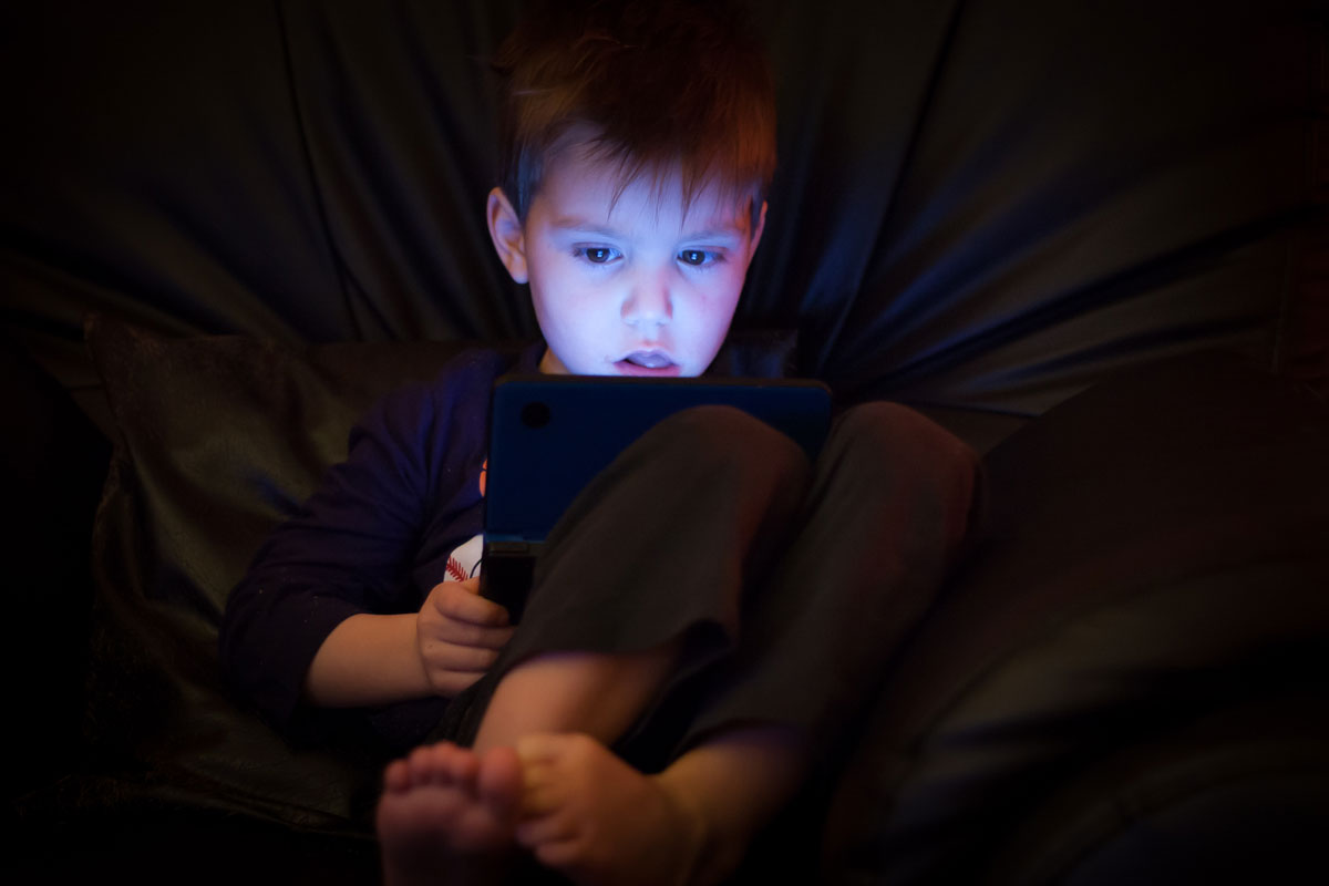 child captivated by technology