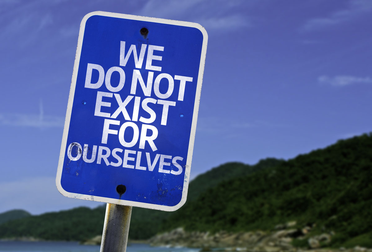 blue road sign that says We Do Not Exist For Ourselves