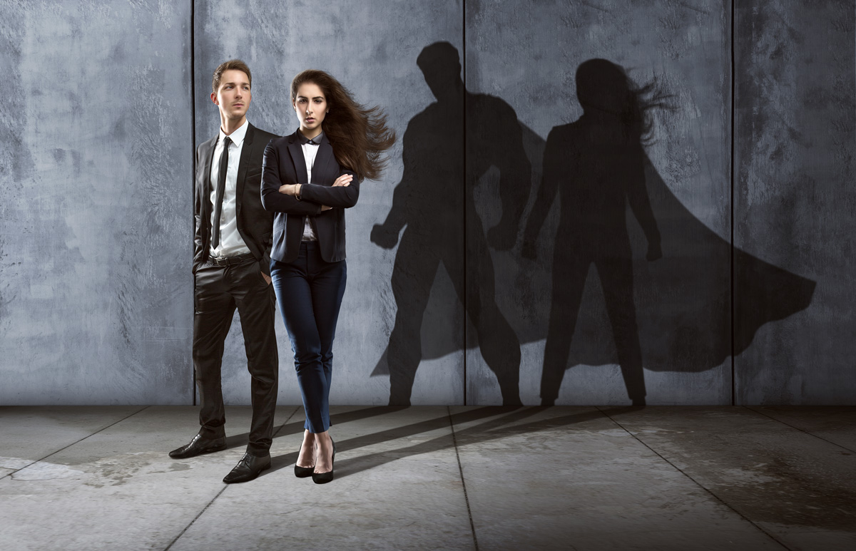 male and female CEO with their shadows in the shape of a super hero